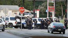 Police block the road during a stand off with a gunman barricaded inside a van in Dallas. (AP)