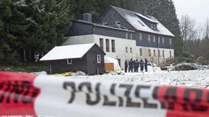 Police investigate near a house in Reichenau, Germany, during the investigation (AP)