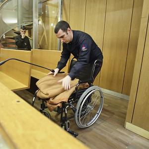 A wheelchair for Pascal Simbikangwa is prepared in the courtroom (AP Photo/Remy de la Mauviniere)