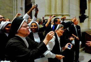 Olive branch: Nuns and other guests take photographs of Pope Francis as he leaves St Patrick's Cathedral in New York in a week in which the pontiff praised nuns, calling them 'women of strength' Photo: Robert Sabo-Pool/Getty Images