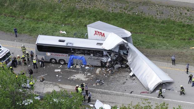 Authorities investigate the scene of a fatal collision between a lorry and a tour bus on Interstate 380. (AP)