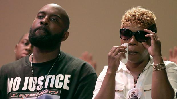 Michael Brown's parents, Michael senior and Lesley McSpadden, at a rally for their son (AP)