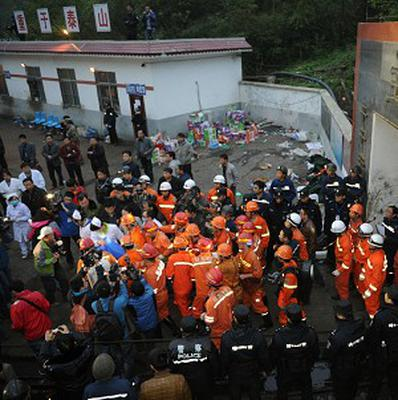 A rescued miner is carried out of a flooded coal mine in China's Guizhou province (AP)