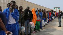 Migrants wait to leave the island of Lampedusa, southern Italy. (AP)