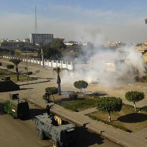 Egyptian security forces fire tear gas to disperse supporters of Mohammed Morsi as they protest at the Al-Azhar University in Cairo (AP)