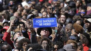 A large crowd gathers near a stage where President Barack Obama will speak and then take a symbolic walk across the Edmund Pettus Bridge, in Selma (AP)