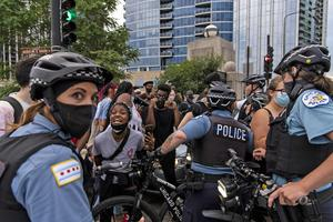 Police confront protesters in Chicago (Tyler LaRiviere/Chicago Sun-Times/AP)