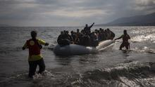 Stock photo. Volunteers rush to assist migrants and refugees as they approach a beach of the Greek island of Lesbos (AP)