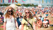 Festival-goers wearing head dresses at Glastonbury