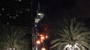 A fire runs up some 20 stories of a building in Dubai (AP)