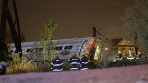 Emergency personnel work at the scene of a train crash in Philadelphia (AP)