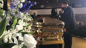 Martin Luther King III takes a moment by George Floyd's casket (Bebeto Matthews/AP)