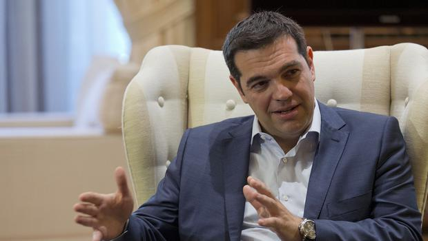 Greek prime minister Alexis Tsipras gestures during a meeting with Stavros Theodorakis, leader of the political party Potami in Athens (AP)
