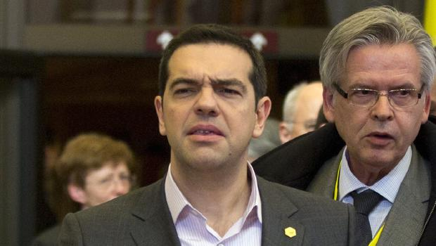 Prime Minister Alexis Tsipras paid a visit to the finance ministry to say that Greece was close to a final agreement on a bailout (AP)