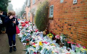 Tributes left outside the house in Oxfordshire of George Michael yesterday following the singer's death Photo: Steve Parsons/PA Wire