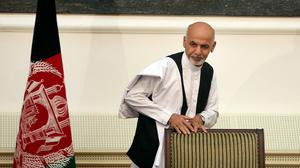 Ashraf Ghani Ahmadzai leaves after signing a power-sharing deal at the presidential palace in Kabul (AP)