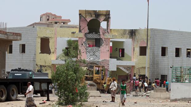People gather at the site of a bombing in Aden, Yemen (AP)