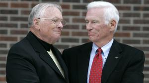 Neil Armstrong, left, with fellow ex-astronaut Gene Cernan, who has died at 82 (AP)