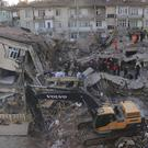 Rescuers search for people buried under the rubble of a collapsed building in Elazig, eastern Turkey (Can Celik/DHA via AP)