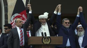 Afghan President Ashraf Ghani, centre, and rival Abdullah Abdullah have agreed a deal to govern together (Rahmat Gul/AP)