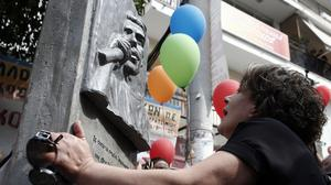 Magda Fyssa, mother of murdered Greek rap singer Pavlos Fyssas, at a plaque unveiled at the site of his death one year ago in Keratsini (AP)
