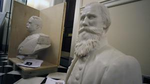 """Busts of Fitzhugh Lee, left, and James E. B """"Jeb"""" Stuart, right sit in a hallway waiting to be boxed after removal from the Old House Chamber inside the Virginia State Capitol in Richmond, Virginia (Bob Brown (richmond Times-Dispatch/AP)"""
