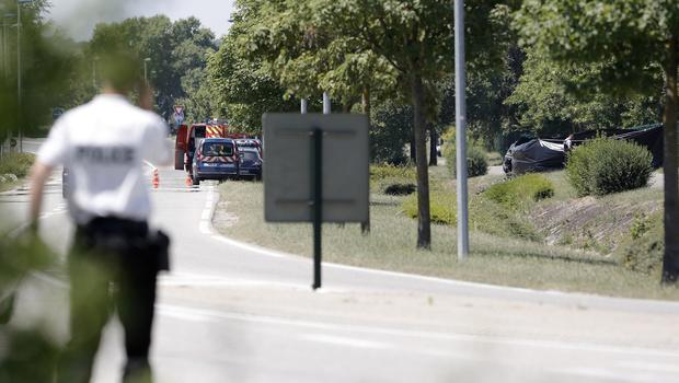 Police officers outside the plant where an attack took place in Saint-Quentin-Fallavier, south-east of Lyon, France (AP)