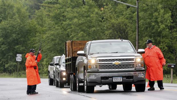 Officers check vehicles at a checkpoint after two murderers escaped from Clinton Correctional Facility. (AP)