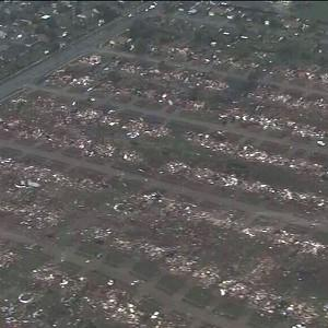 Homes flattened outside Moore, Oklahoma, after a tornado as much as a mile wide roared through the city (AP/KFOR-TV)