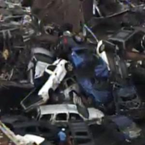 A car pile-up outside Moore, Oklahoma, after a tornado as much as a mile wide roared through the city (AP/KFOR-TV)