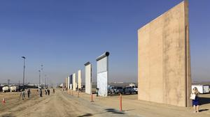 Contractors have completed eight prototypes of President Donald Trump's proposed border wall with Mexico (AP Photo/Elliott Spagat)