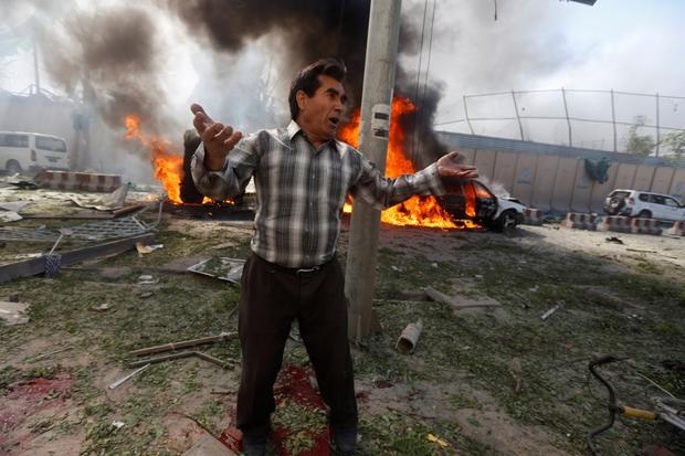 An Afghan man reacts at the site of the blast in Kabul. Photo: Reuters