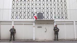 Soldiers stand guard outside a synagogue in Paris (AP)