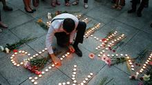Candle light vigil: A Ukrainian man lights up candles for the victims of MH17