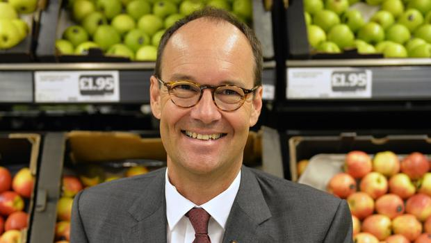 Mike Coupe said he is not stepping down as the chief of Sainsbury's because of its failed Asda merger (Sainsbury's/PA)