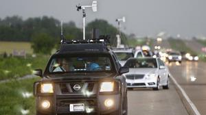 Stormchasers and spectator vehicles clog the road (AP)