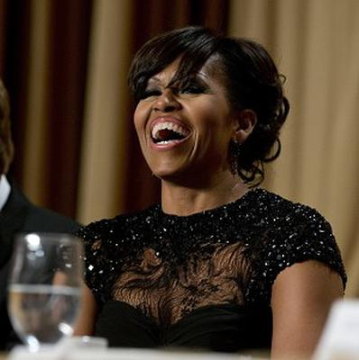 First Lady Michelle Obama laughs during the White House Correspondents' Association Dinner (AP)
