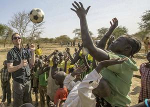 GOAL ceo Barry Andrews plays football with children in Twic. Mark Condren