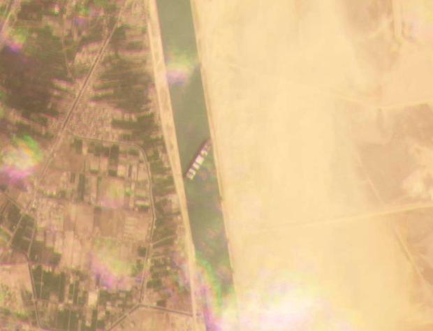This satellite image from Planet Labs Inc. shows the cargo ship MV Ever Given stuck in the Suez Canal near Suez, Egypt, Tuesday, March 23, 2021.