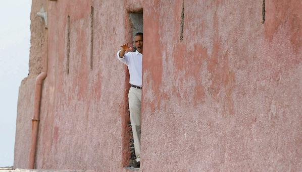U.S. President Barack Obama is pictured at the 'door of no return' as he visits the Maison Des Ecslaves