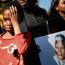 Well-wishers, above, gather outside the hospital in Pretoria where Nelson Mandela is being treated