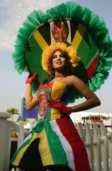A racegoer dons a Mandela-inspired outfit to participate in a fashion contest at the Durban July horse racing event in South Africa yesterday