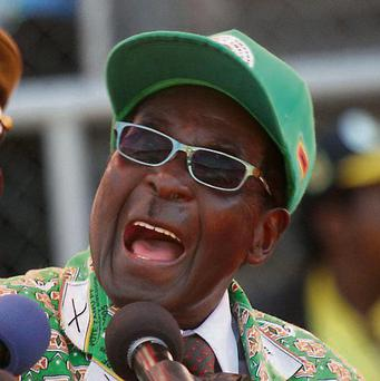 Robert Mugabe: party accused of seeking to rig vote