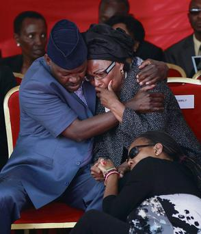 Former Kenyan Ambassador to Ireland Catherine Mwangi, right, is comforted at the funeral of her son Mbugua Mwangi, who was murdered in the Westgate Shopping Mall attack.