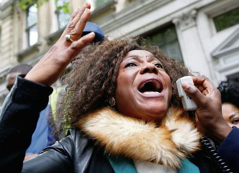 A protestor demonstrates against the kidnapping of school girls in Nigeria, outside the Nigerian Embassy in London