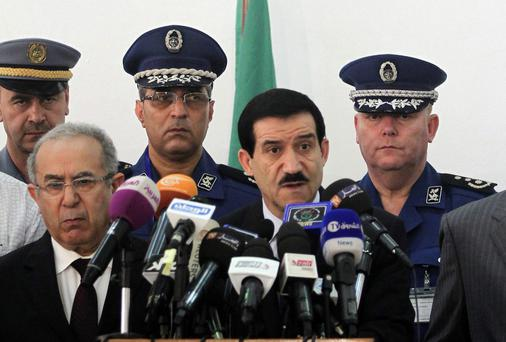 Algeria's transport minister Amar Ghoul (2nd R) speaks during a news conference at Houari Boumedinne airport in Algiers