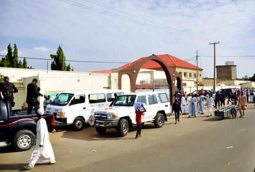 Ambulances and security officers arrive at the Murtala Muhammad hospital after a suicide bomb attack in Kano, northern Nigeria