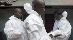 A burial team in Freetown after removing an ebola victim.
