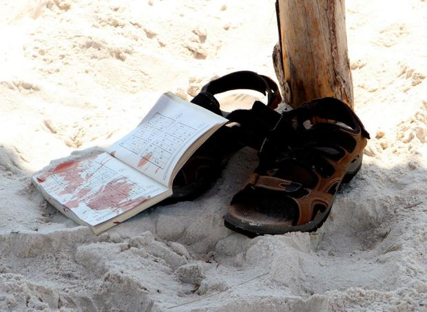 The bloodstained belongings of a tourist are seen on the sand in the resort town of Sousse, Tunisia