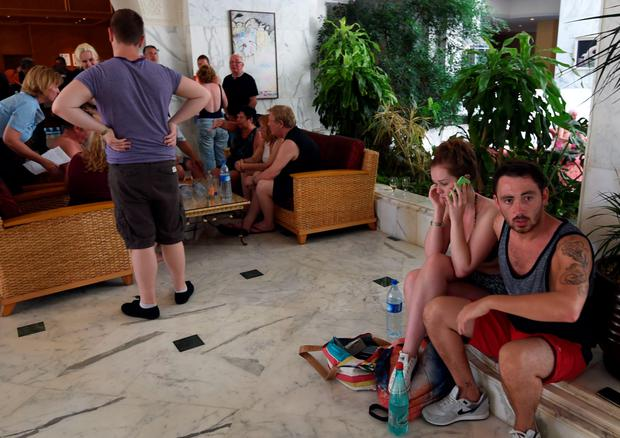 Tourists react at the Imperial hotel in the resort town of Sousse. Photo: Getty